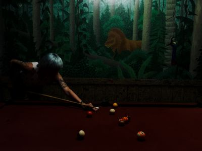 Liesl playing pool at the Lion's Den Hotel near Cooktown, Australia